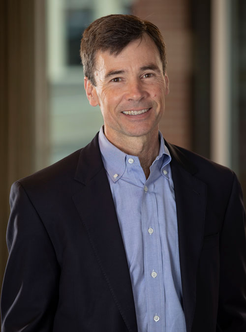 Headshot of Scott Brown, New Energy Capital CEO and Managing Partner